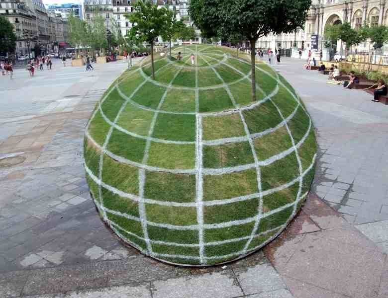 Optical illusion created on display outside Paris City Hall. Looks like a giant grass sphere, but it's actually flat.